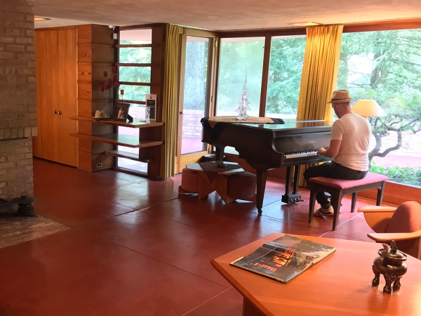 Cory plays a grand piano that was once played by Frank Lloyd Wright at the Laurent House in Rockford, Illinois.
